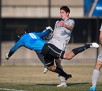 Andy Riemer (20) of Georgetown tries to shoot the ball past Drew Ilijevski (0) of San Diego during the game at North Kehoe Field in Washington, DC.  Georgetown defeated San Diego, 3-1.