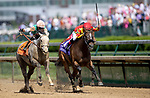 April 30, 2021 : Obligatory, #7, ridden by jockey Jose Ortiz, wins the Eight Belles Stakes on Kentucky Oaks Day at Churchill Downs on April 30, 2021 in Louisville, Kentucky. Carolyn Simancik/Eclipse Sportswire/CSM