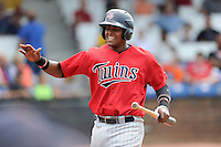 Catcher Brian Navarreto (24) of the Elizabethton Twins is congratulated after scoring a run in a game against the Johnson City Cardinals on Sunday, July 27, 2014, at Howard Johnson Field at Cardinal Park in Johnson City, Tennessee. The game was suspended due to weather in the fifth inning. (Tom Priddy/Four Seam Images)