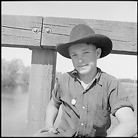 San Joaquin Valley, California. Contract Labor. Sixteen years old and the possessor of a labor contractor's button... - April 1940<br /> <br /> Partridge, Rondal, 1917-, Photographer