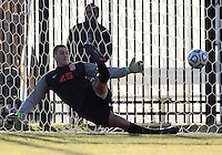 WASHINGTON, DC - NOVEMBER 25, 2012: Alex Bono (25) of Syracuse University goes the wrong way during the penalty kick shootout during an NCAA championship third round match at North Kehoe field, in Georgetown, Washington DC on November 25. Georgetown won 2-1 after overtime and penalty kicks.