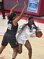 Arkansas' Erynn Barnum looks to shoot under pressure from Texas A&M's Ciera Johnson Sunday Jan. 10, 2021 at Bud Walton Arena in Fayetteville. Arkansas lost 74-73. Visit nwaonline.com/210111Daily/ and nwadg.com/photos. (NWA Democrat-Gazette/J.T. Wampler)