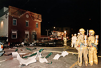 October 1st,1995  File Photo - Montreal (qc) CANADA -  Firemen outsite the bombed Rock machine place in Montreal's east end