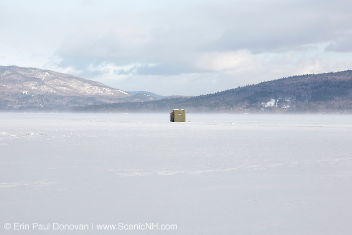 Bobhouse on Newfound Lake from the shore of Wellington State Park in Bristol, New Hampshire during the winter months. A glacial lake, Newfound Lake is is known for its depth and clarity.