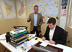 Lt. Governor candidate Sen. Mark Hutchison, R-Las Vegas, left, works with campaign staffer Ryan Cherry in his campaign office in Reno, Nev., on Tuesday, Nov. 4, 2014. (AP Photo/Cathleen Allison)