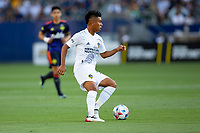 CARSON, CA - JUNE 19: Efrain Alvarez #26 of the Los Angeles Galaxy turns with the ball during a game between Seattle Sounders FC and Los Angeles Galaxy at Dignity Health Sports Park on June 19, 2021 in Carson, California.