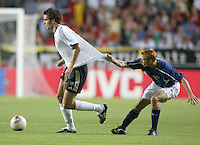 Frankie Hejduk tries to slow down a German player. The USA lost to Germany 1-0 in the Quarterfinals of the FIFA World Cup 2002 in South Korea on June 21, 2002.