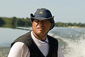 Pará State, Brazil. Xingu River; boatman Paulo Juruna at the helm.