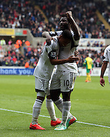 Saturday, 29 March 2014<br /> Pictured L-R: Jonathan de Guzman of Swansea celebrating his second goal with team mate Wilfried Bony.<br /> Re: Barclay's Premier League, Swansea City FC v Norwich City at the Liberty Stadium, south Wales, UK.