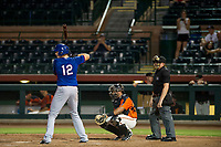 AZL Rangers catcher Sam Huff (12) at bat while family members watch from the stands against the AZL Giants on August 22 at Scottsdale Stadium in Scottsdale, Arizona. AZL Rangers defeated the AZL Giants 7-5. (Zachary Lucy/Four Seam Images via AP Images)