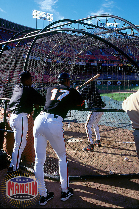 SAN FRANCISCO, CA - Darryl Strawberry of the San Francisco Giants, standing next to Giants hitting coach Bobby Bonds, watches Barry Bonds take batting practice before a game at Candlestick Park in San Francisco, California in 1994. Photo by Brad Mangin