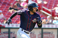 Cedar Rapids Kernels outfielder Gilberto Celestino (8) runs to first base during a Midwest League game against the Peoria Chiefs on May 26, 2019 at Perfect Game Field in Cedar Rapids, Iowa. Cedar Rapids defeated Peoria 14-1. (Brad Krause/Four Seam Images)