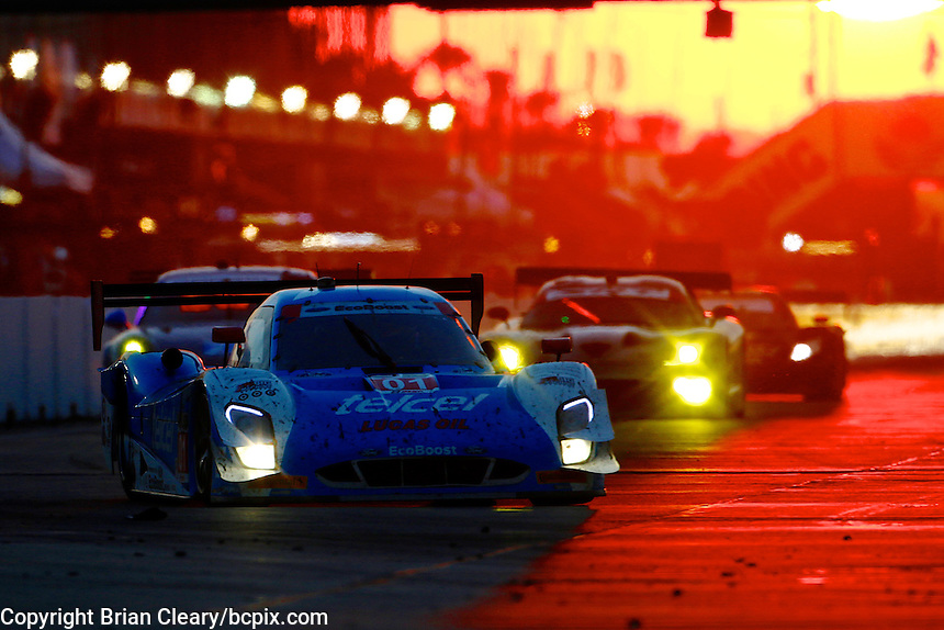 Sunset action, the 12 Hours of Sebring, Sebring International Raceway, Sebring, FL, March 2014.  (Photo by Brian Cleary/www.bcpix.com)