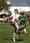 Douglas' Lexi Weaver battles Manogue's Mackenzie Spaich during action Tuesday, Sept. 20, 2011 at Douglas High School in Gardnerville, Nev.  Douglas won 4-1..Photo by Cathleen Allison