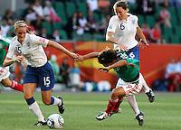 Wolfsburg , 270611 , FIFA / Frauen Weltmeisterschaft 2011 / Womens Worldcup 2011 , Gruppe B  ,  ..England - Mexico ..Sophie Bradley und Casey Stoney (England) gegen Monica Ocampo (Mexico) ..Foto:Karina Hessland ..