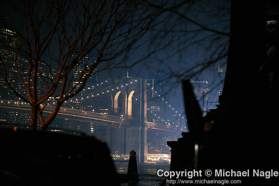"""NEW YORK - JANUARY 23, 2007:   The Brooklyn Bridge is lit up during the filming of """"I Am Legend"""" on January 23, 2007 in New York City.  The movie stars Will Smith.  (PHOTOGRAPH BY MICHAEL NAGLE)"""