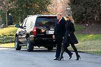 President Donald J. Trump and First Lady Melania Trump walk across the South Lawn driveway of the White House Wednesday, Dec. 23, 2020, before boarding Marine One to begin their trip to Florida. (Official White House Photo by Andrea Hanks)