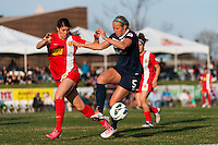 Sky Blue FC defender Kendall Johnson (5) and Western New York Flash defender Brittany Taylor (13). Sky Blue FC defeated the Western New York Flash 1-0 during a National Women's Soccer League (NWSL) match at Yurcak Field in Piscataway, NJ, on April 14, 2013.