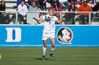 Cary, North Carolina - Sunday December 6, 2015: Rebecca Quinn (5) of the Duke Blue Devils traps the ball with her chest during first half action against the Penn State Nittany Lions at the 2015 NCAA Women's College Cup at WakeMed Soccer Park.  The Nittany Lions defeated the Blue Devils 1-0.