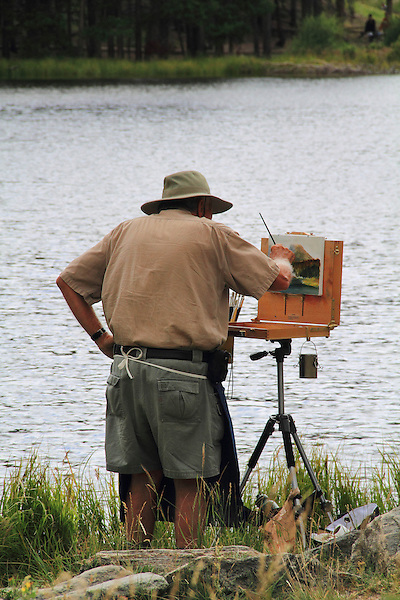 Caucasian senior citizen painting a landscape at Sprague Lake in Rocky Mountain National Park, Colorado, USA .  John offers private photo tours in Denver, Boulder and throughout Colorado. Year-round.