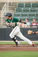 Rony Cabrera (2) of the Greensboro Grasshoppers follows through on his swing against the Kannapolis Intimidators at CMC-Northeast Stadium on June 9, 2015 in Kannapolis, North Carolina.  The Intimidators defeated the Grasshoppers 6-4.  (Brian Westerholt/Four Seam Images)