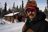 Volunteer checker and  Sheriff of Rohn, Terry Boyles, takes a break at Rohn during the 2010 Iditarod