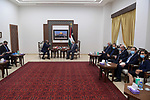Palestinian President Mahmoud Abbas, meets with British Foreign Secretary Dominic Raab, in the West Bank city of Ramallah, on May 26, 2021. Photo by Thaer Ganaim
