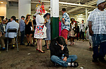 LOUISVILLE, KY - MAY 05: Fans hide from the downpour on Kentucky Derby Day at Churchill Downs on May 5, 2018 in Louisville, Kentucky. (Photo by Eric Patterson/Eclipse Sportswire/Getty Images)