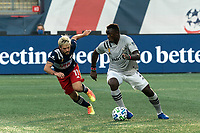 FOXBOROUGH, MA - SEPTEMBER 23: Victor Wanyama #2 of Montreal Impact brings the ball forward as Kelyn Rowe #11 of New England Revolution defends during a game between Montreal Impact and New England Revolution at Gillette Stadium on September 23, 2020 in Foxborough, Massachusetts.