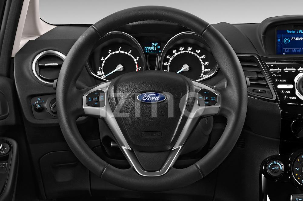 Car pictures of steering wheel view of a 2014 Ford FIESTA Sport 3 Door Hatchback 2WD Steering Wheel