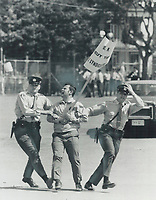 1969 FILE PHOTO - ARCHIVES -<br /> <br /> Sign-Toting demonstrator is dragged unceremoniously away by police officers from outside the Quebec city Coliseum where Jean-Jacques Bertrand was confirmed at Union Nationale leader.<br /> <br /> 1969<br /> <br /> PHOTO : Boris Spremo - Toronto Star Archives - AQP
