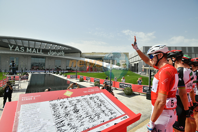 Race leader Red Jersey Alexander Kristoff (NOR) and UAE Team Emirates at sign on before the start of Stage 2 of the 2018 Abu Dhabi Tour, Yas Island Stage running 154km from Yas Mall to Yas Beach, Abu Dhabi, United Arab Emirates. 22nd February 2018.<br /> Picture: LaPresse/Massimo Paolone   Cyclefile<br /> <br /> <br /> All photos usage must carry mandatory copyright credit (© Cyclefile   LaPresse/Massimo Paolone)
