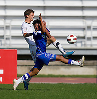 Marc Pelosi (10) of the United States tries to cross the ball past Brayan Landaverde (6) of El Salvador during the quarterfinals of the CONCACAF Men's Under 17 Championship at Catherine Hall Stadium in Montego Bay, Jamaica. The USA defeated El Salvador, 3-2, in overtime.