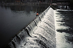 A man taking a bath in the Tuo River in the town of Fenghuang in the Hunan Province, China.