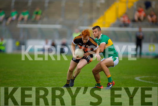 Stacks Shane O'Callaghan under pressure from Mitchels John Horgan in the Tralee Town Board Senior Football Championship final.