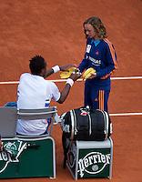 France, Paris, 04.06.2014. Tennis, French Open, Roland Garros,  Gael Monfils (FRA) gets some bananas<br /> Photo:Tennisimages/Henk Koster