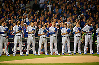 Chicago Cubs (L-R) John Lackey, Jason Hammel, Mike Montgomery, Travis Wood, Jon Lester, Joe Smith, Rob Zastrynzy, and Jason Heyward stand for the national anthem before before Game 3 of the Major League Baseball World Series against the Cleveland Indians on October 28, 2016 at Wrigley Field in Chicago, Illinois.  (Mike Janes/Four Seam Images)