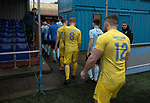 The players leaving the pitch after Cambrian and Clydach Vale (in blue) took on Cwmbran Celtic at King George's New Field in a Welsh League Division One match, the top division of the Welsh Football League and the second level of the Welsh football league system. The club, formed in 1965 reached the final of the 2018-19 League Cup final and can count on ex-England manager Terry Venables as a former club chairman. Cambrian and Clydach Vale won this match 2-0, watch by a crowd of around 100 spectators.