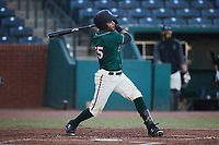 Fabricio Macias (25) of the Greensboro Grasshoppers at bat against the Hickory Crawdads at First National Bank Field on May 6, 2021 in Greensboro, North Carolina. (Brian Westerholt/Four Seam Images)