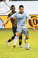 KANSAS CITY, UNITED STATES - AUGUST 25: Roger Espinoza #15 of Sporting Kansas City with the ball  a game between Houston Dynamo and Sporting Kansas City at Children's Mercy Park on August 25, 2020 in Kansas City, Kansas.