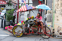 George Town, Penang, Malaysia.  Trishaw Driver Waiting for a Passenger.