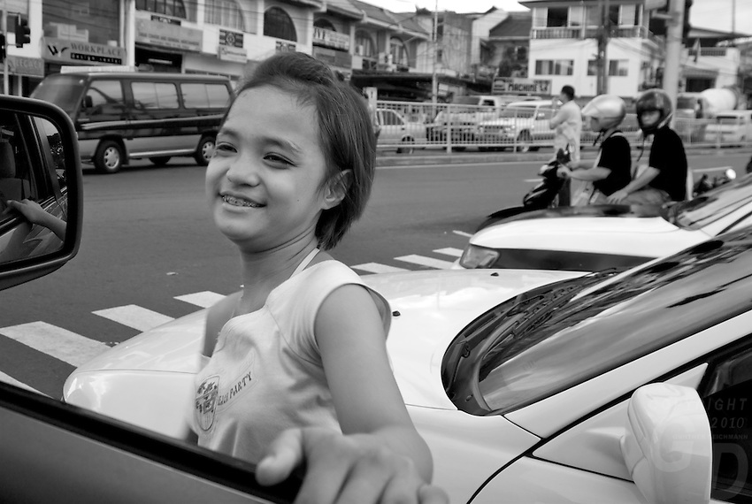 Street Children view from the car window Manila, Philippines