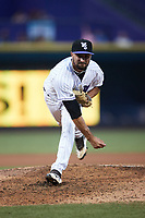 Winston-Salem Dash relief pitcher Vince Arobio (22) follows through on his delivery against the Hickory Crawdads at Truist Stadium on July 10, 2021 in Winston-Salem, North Carolina. (Brian Westerholt/Four Seam Images)