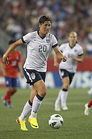 USWNT substitute forward Abby Wambach (20) brings the ball forward. In an international friendly, the U.S. Women's National Team (USWNT) (white/blue) defeated Korea Republic (South Korea) (red/blue), 4-1, at Gillette Stadium on June 15, 2013.