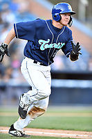 Asheville Tourists catcher Willie Maclver (23) runs to first base during a game against the Augusta GreenJackets at McCormick Field on April 6, 2019 in Asheville, North Carolina. The Tourists defeated the GreenJackets 6-3. (Tony Farlow/Four Seam Images)