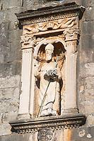 Carved stone statue of the patron saint St Blaise above and guarding the Vrata Pile city gate Dubrovnik, old city. Dalmatian Coast, Croatia, Europe.