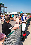 OLDSMAR, FL - JANUARY 21: Edwin Gonzalez, taking a selfie with a fan, after winning the 4yr olds and up claiming race, on Skyway Festival Day at Tampa Bay Downs on January 21, 2017 in Oldsmar, Florida. (Photo by Douglas DeFelice/Eclipse Sportswire/Getty Images)