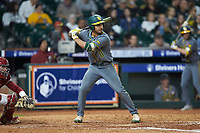Ricky Martinez (11) of the Baylor Bears at bat against the Arkansas Razorbacks in game nine of the 2020 Shriners Hospitals for Children College Classic at Minute Maid Park on March 1, 2020 in Houston, Texas. The Bears defeated the Razorbacks 3-2. (Brian Westerholt/Four Seam Images)