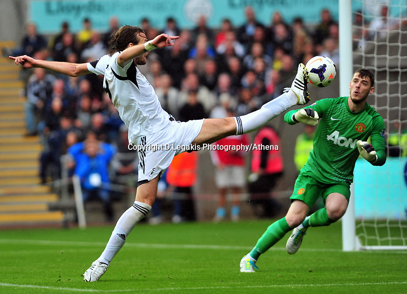 Michu reaching for goal.<br /> Saturday 17 August 2013<br /> Pictured: <br /> Re: Barclays Premier League Swansea City v Manchester United at the Liberty Stadium, Swansea, Wales