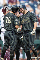 Vanderbilt Commodores outfielder Stephen Scott (19) is greeted by teammate Pat DeMarco (18) after his second home run of Game 8 of the NCAA College World Series against the Mississippi State Bulldogs on June 19, 2019 at TD Ameritrade Park in Omaha, Nebraska. Vanderbilt defeated Mississippi State 6-3. (Andrew Woolley/Four Seam Images)